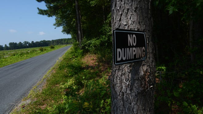 "A ""No Dumping"" sign is attached to a tree on Beacon Road in Melfa to discourage roadside littering. Despite the sign, Waste Watchers, a local anti-litter group, found Beacon Road was one of the worst it surveyed in Accomack County recently."
