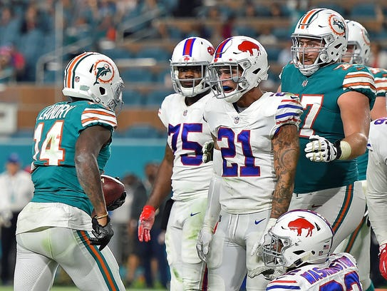 Miami Dolphins wide receiver Jarvis Landry (14) confronts