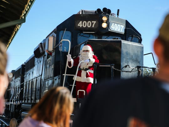 Santa arrives for the Santa's Santa Fe Christmas Saturday, Nov. 25, 2017, at the Railway Museum of San Angelo.