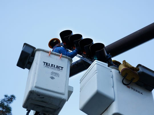 COT Traffic Signal Technicians install new flashing