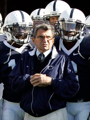 Penn State football coach Joe Paterno stands with his team before a game against Wisconsin on Oct. 13, 2007.