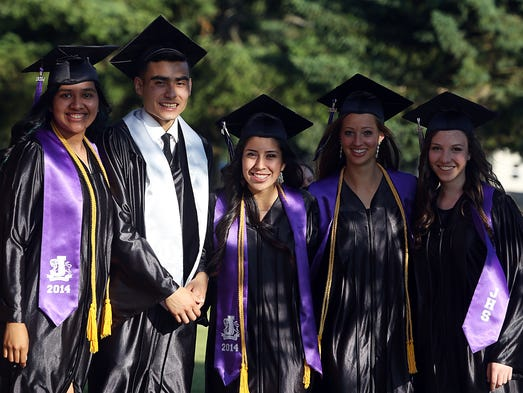 Graduating seniors congregate outside prior to their Jefferson High School graduation ceremony Friday May 30, 2014.