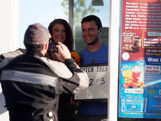 Paul Peloquin takes a photo of baristas at a Dutch Bros. in Woodburn Wednesday morning as part of a 3,500 mile motorcycle journey to help raise money for Shelly's House. He will hit 26 more Dutch Bros. locations in six states before he finishes Saturday.