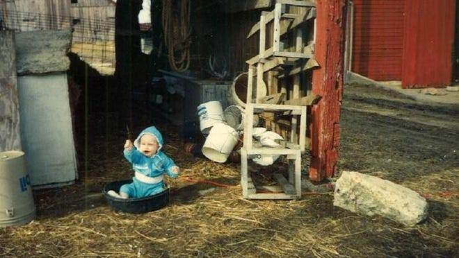 Growing up in the country, you learn from an early age how to keep yourself entertained. Lauren Ehrler, pictured here in 1992, on the acreage she grew up on in rural Jackson County.