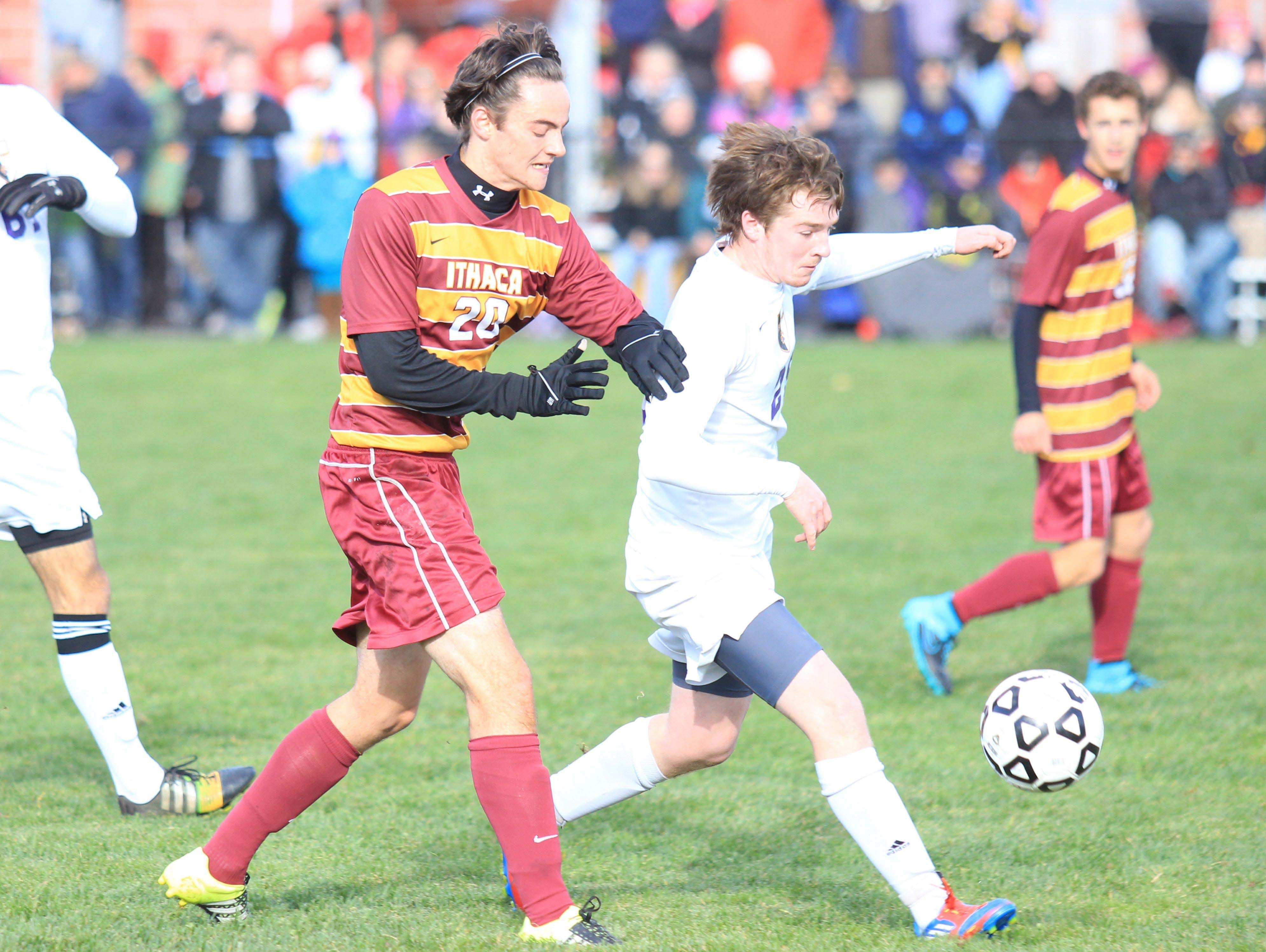 Ithaca's Andrew Araneo (left) battles Ballston Spa defender during NYSPHSAA semi final in Middletown, NY