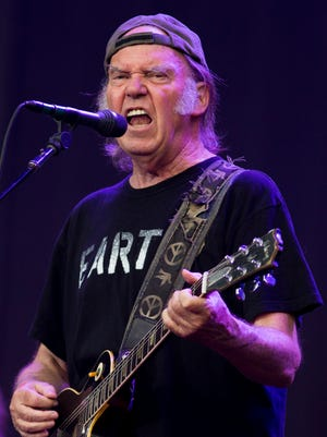 Rock star Neil Young performs on stage at the British Summer Time Festival on July 12 in London.
