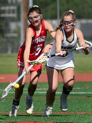 Canandaigua's Clancy Rheude, left, chases a loose ball against Fayetteville-Manlius' Kiera Shanley during the 2017 NYSPHSAA Girls Lacrosse Championships Class B semifinal at SUNY Cortland on Friday, June 9, 2017. Canandaigua's season ended with a 17-11 loss to Fayetteville-Manlius-III.