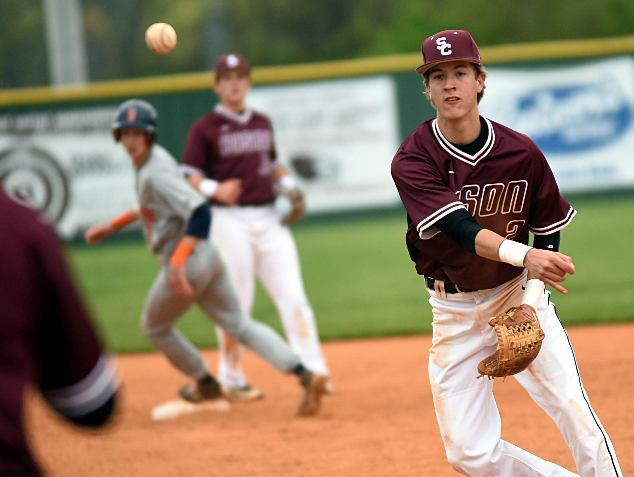 Station Camp High senior second baseman Blair Flatt throws to senior first baseman Lucas Gross for a seventh-inning putout