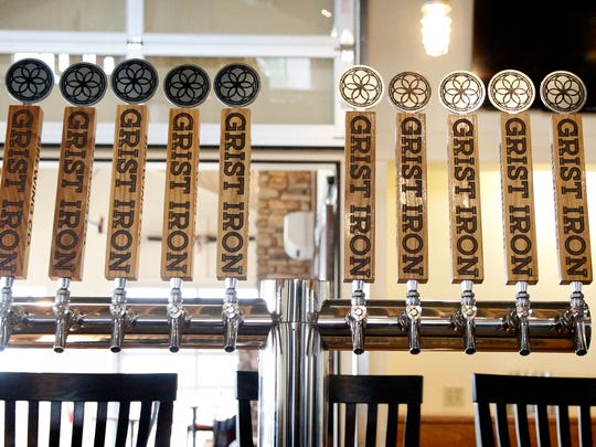 Beer taps at Grist Iron Brewing Co. at 4880 State Route 414 in Burdett.