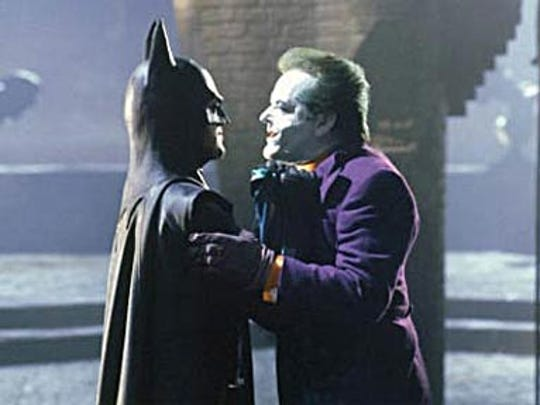 "Michael Keaton as Batman and Jack Nicholson as the Joker in Tim Burton's 1989 film ""Batman."""