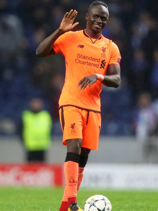 Liverpool's Sadio Mane celebrates at the end of the Champions League round of sixteen first leg soccer match between FC Porto and Liverpool FC at the Dragao stadium in Porto, Portugal, Wednesday, Feb. 14, 2018. Mane scored three goals in Liverpool's 5-0 win. (AP Photo/Luis Vieira)