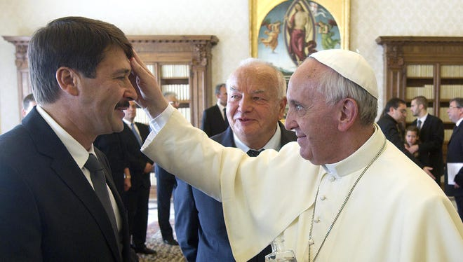 Pope Francis blesses Hungary's President Janos Ader during a private audience at the Vatican.