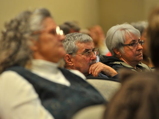 Audience listens during Wednesday night's state Assembly candidate debate involving Dave Heaton, Mandy Wright, John Spiros, and Nancy Stencil at the UW Center for Civic Engagement in Wausau.