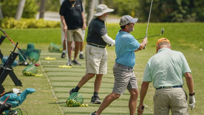 Golfers were still at the driving range at the North Palm Beach Country Club in North Palm Beach last week, but all courses in Palm Beach County have been ordered to close due to the coronavirus pandemic.