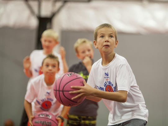NBA All-Star Isaiah Rider teaches basketball techniques to area youth at a basketball skills summer camp held at the House of Hoops in this undated photo in St. George.