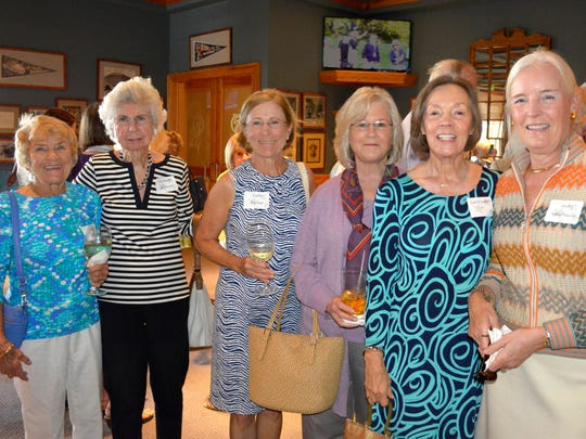 A group of Starfest guests mingle during the reception prior to the Starfest luncheon.