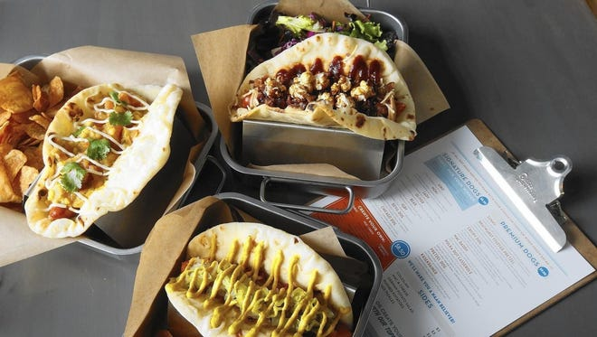 Short Leash Hot Dogs is known for creative hot dog topping combinations.
