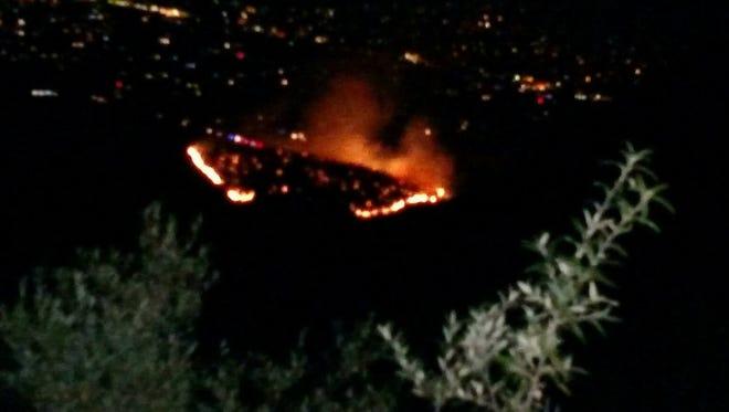 Firefighters battle wildfire in Carr Canyon near Sierra Vista.