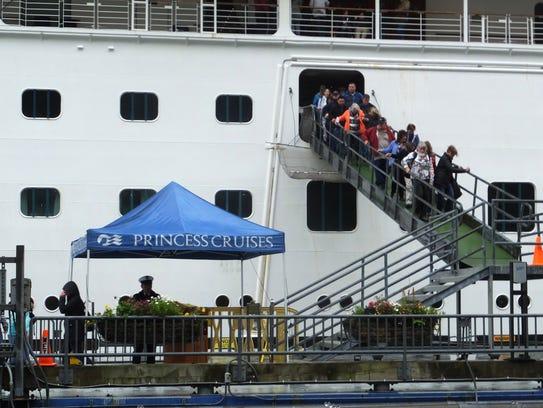 Passengers of the Emerald Princess cruise ship disembark