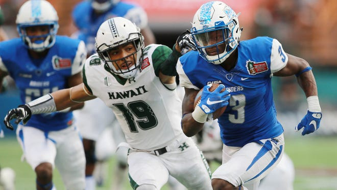 Dec 24, 2016; Honolulu, HI, USA;  Hawaii Warriors defensive back Jalen Rogers (19) tries to pull down Middle Tennessee Blue Raiders wide receiver Richie James (3) during the third quarter at Hawaiian Tel Federal Credit Union Field. Mandatory Credit: Marco Garcia-USA TODAY Sports