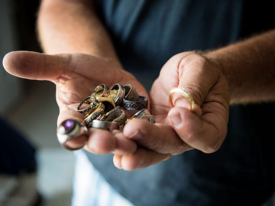 Steve Zabrauskas, an amateur treasure hunter, displays some of the rings he has found while interviewed at home Monday, July 9, 2018, in Port St. Lucie. He's found countless rings, watches and other assorted metals and items throughout the years, and said he tries to track down the owners of the lost items when possible, and has had success in the past.