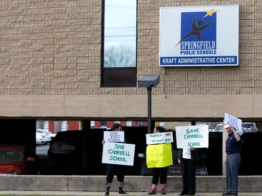 Protestors stand outside the Kraft Administration Center protesting the possible closure of Campbell Elementary School on Tuesday, April 17, 2018.