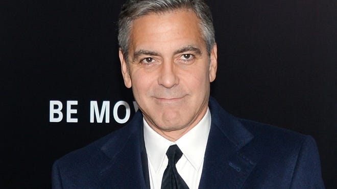 """FILE - In this Feb. 4, 2014 file, director and actor George Clooney attends the premiere of """"The Monuments Men"""" at the Ziegfeld Theatre in New York. Clooney, who married human rights lawyer Amal Alamuddin on Sept. 27 in Venice, Italy, made an appearance at New York Comic Con, Thursday, Oct. 9, 2014 for a panel on his upcoming film, """"Tomorrowland."""" (Photo by Evan Agostini/Invision/AP, File)"""