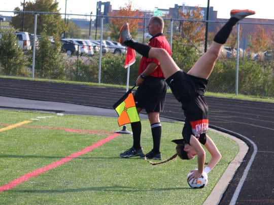 Loveland's Danielle Kenyon executes a flip throw-in that led to a Brice Grieshop header for goal in the DI regional final game with Springboro Nov. 5, 2016, at Lakota East.