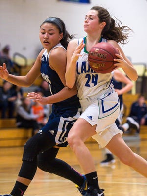 Colchester's Gabby Goselin drives around Burlington's Lyly Dang in Colchester on Tuesday, December 27, 2016.