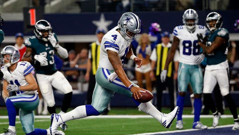 In this Sunday, Oct. 30, 2016, file photo, Dallas Cowboys quarterback Dak Prescott (4) runs the ball for a touchdown against the Philadelphia Eagles in the first half of an NFL football game in Arlington, Texas.  As Dallas rookie quarterback's winning streak grows, Jerry Jones keeps modifying the answer for what happens when Tony Romo is ready. The latest change from the Cowboys owner and GM: Dallas should stay with the hot hand, and Romo is fine with it. (AP Photo/Michael Ainsworth, File)