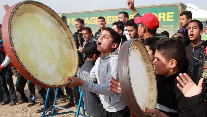 Displaced Iraqi people, who fled the violence in the Iraqi city of Ramadi, celebrate after their city was liberated from the Islamic State group on Dec. 29, 2015, at the Alkzenzanah camp in the capital Baghdad. Iraqi Prime Minister Haider al-Abadi congratulated the fighters who retook Ramadi, vowing to liberate the second city of Mosul and rid the entire country of the Islamic State in 2016.