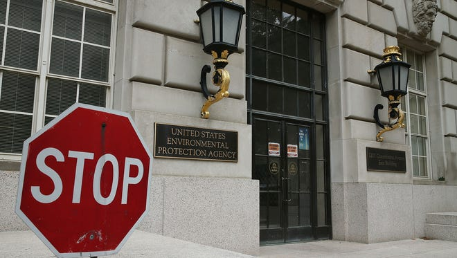 WASHINGTON, DC - MAY 24:  A stop sign stands outside the Environmental Protection Agency (EPA) building on May 24, 2013 in Washington, DC (Photo by Mark Wilson/Getty Images)