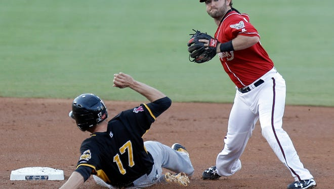 El Paso shortstop Casey McElroy looks to turn a double play after getting Salt Lake's Nick Buss out at second.