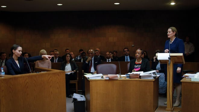 Former gymnast Rachael Denhollander who once was a patient of Larry Nassar identifies Nassar after Assistant Attorney General and lead prosecutor Angela Povilaitis asks Denhollander if Nassar was seated in the courtroom Friday, May 12, 2017, in District Court Judge Donald Allen Jr.'s 55th District Court.