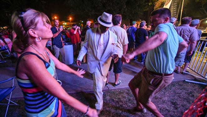 Blues fans get their dance on as they listen to guitarist Coco Montoya on stage as the final act of the 2017 W.C. Handy Blues and Barbecue Festival Saturday, June 17, 2017.