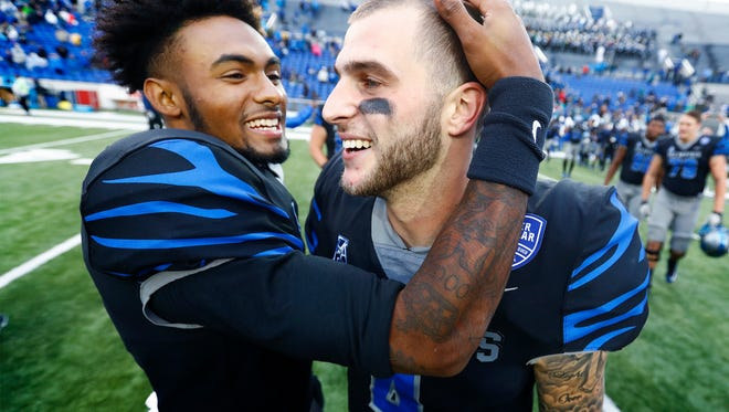 Memphis starting quarterback Riley Ferguson celebrates with his backup David Moore after defeating SMU during 66-45  in Memphis, Tenn., Saturday, November 18, 2017.