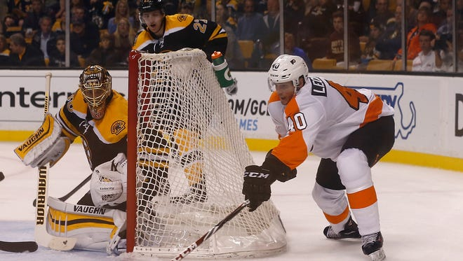 BOSTON, MA - OCTOBER 8: Vincent Lecavalier #40 of the Philadelphia Flyers attempts to shoot by Tuukka Rask #40 of the Boston Bruins in the second period in their NHL season opener on October 8, 2014 in Boston, Massachusetts.  (Photo by Jim Rogash/Getty Images)