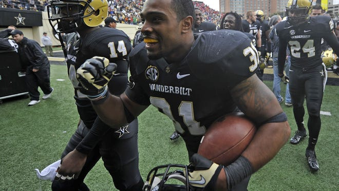 FILE - Vanderbilt safety Javon Marshall (31) and other players walk back to the locker room after a 31-27 win over Georgia in Nashville, Tenn., Saturday, Oct. 19, 2013.
