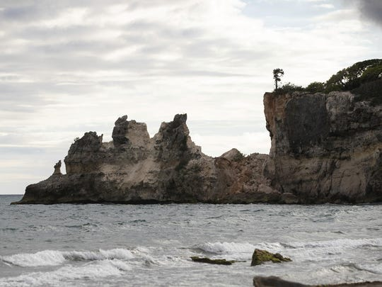 """A natural formation known as """"Punta Ventana,"""" or Window Point, stands without the bridge that once created the formation of the window, or a hole, in Guayanilla, Puerto Rico, Monday, Jan. 6, 2020. The natural bridge collapsed during the morning's earthquake. (AP Photo/Jorge A. Ramirez Portela)"""