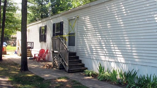This Aug. 14, 2015, photo shows the mobile home where a couple and their two young children were found dead in Grand Traverse County's Garfield Township, according to authorities.