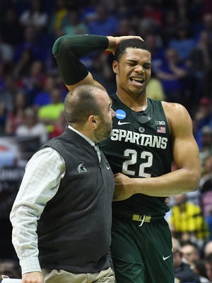 Michigan State Spartans forward Miles Bridges is looked at by the trainer after sustaining an injury against the Kansas Jayhawks during the second round of the 2017 NCAA tournament at BOK Center on March 19, 2017 in Tulsa, Okla.