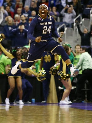 Notre Dame's Arike Ogunbowale reacts after hitting the winning shot against Connecticut.