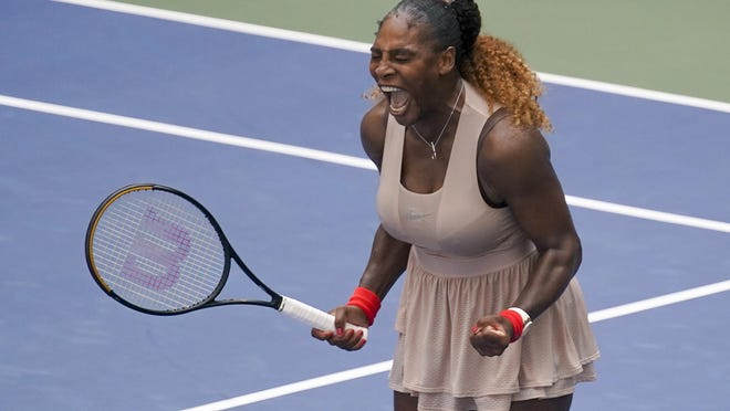 Serena Williams reacts after defeating Maria Sakkari, of Greece, during the quarterfinals of the U.S. Open on Monday.