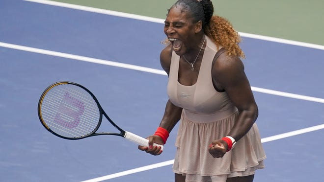 Serena Williams celebrates after defeating Maria Sakkari in the quarterfinals of the U.S. Open on Monday.