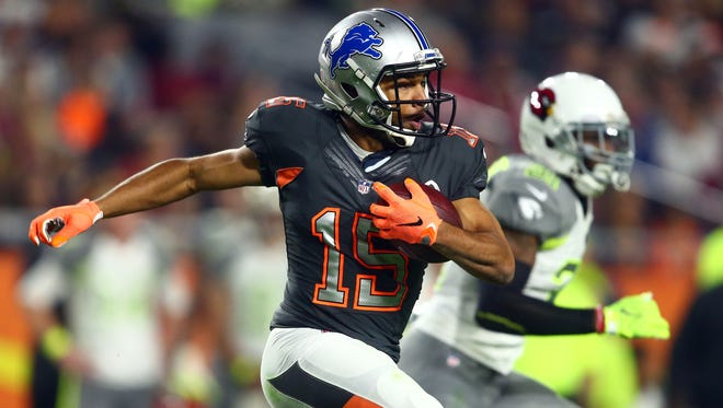 Jan 25, 2015; Team Irvin wide receiver Golden Tate of the Detroit Lions (15) runs with the ball against Team Carter in the 2015 Pro Bowl at University of Phoenix Stadium.