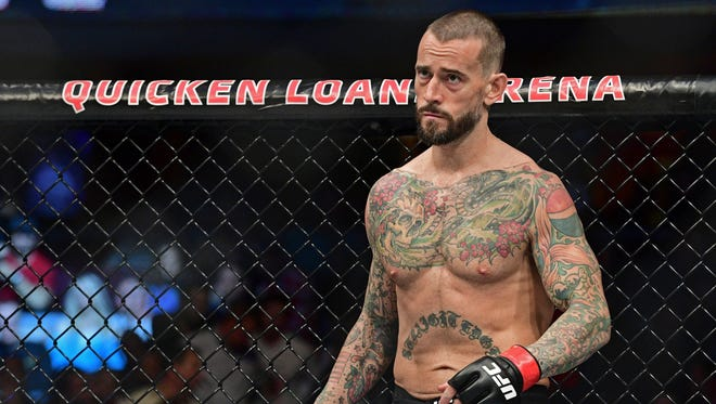 """In this Saturday, Sept. 10, 2016, file photo, CM Punk stands in his corner before a welterweight bout at """"UFC 203"""" in Cleveland. Punk earlier this week was cleared by a jury of defamation and invasion of privacy in a lawsuit brought by a wrestling doctor. On Saturday at """"UFC 225,"""" he lost to Mike Jackson in an unanimous decision."""