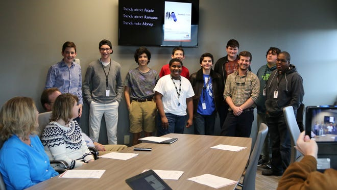Students from NEXT High School pitched a branding and marketing campaign to Mauldin officials Thursday at City Hall. It was the culmination of a 12-week seminar taught by Mauldin Office of Cultural Affairs Administrator George McLeer, third from right.