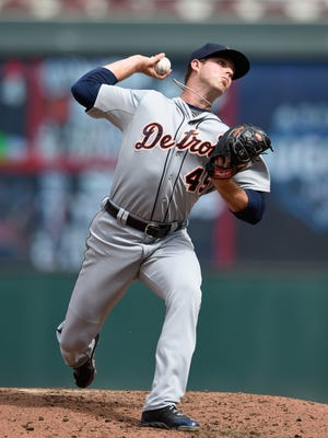 Buck Farmer of the Detroit Tigers delivers a pitch against the Minnesota Twins on July 11, 2015, at Target Field in Minneapolis.