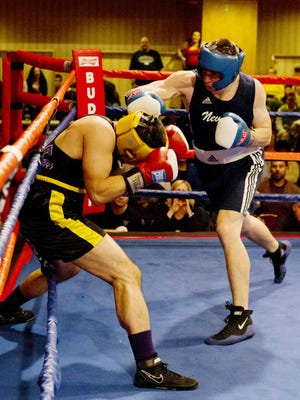 Nevada's Garrett Felling fights Max McDonald from Washington in the 185 pound division of the College Boxing Western Regional Championships held at the Eldorado Casino Convention Center on March 15, 2014.