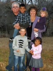 Cancer survivor Sheridy Walker, standing top right,